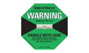 A Green ShockWatch Impact Indicator With A Device That Turns Red Upon Impact And Reminders To Handlers