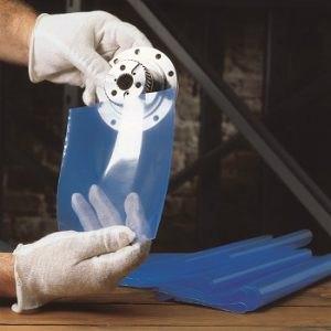 A man placing a metal part in a transparent blue colour VCI Bag Clear Pak® 5000
